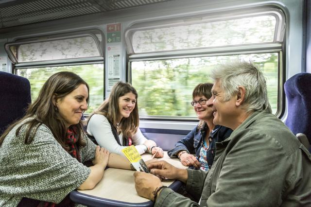 group-of-four-friends-on-train.jpg