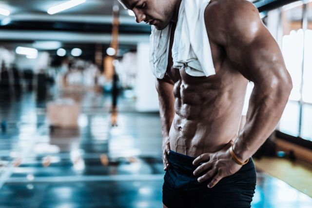 young-man-tired-after-training-showing-his-royalty-free-image-867351234-1555686029